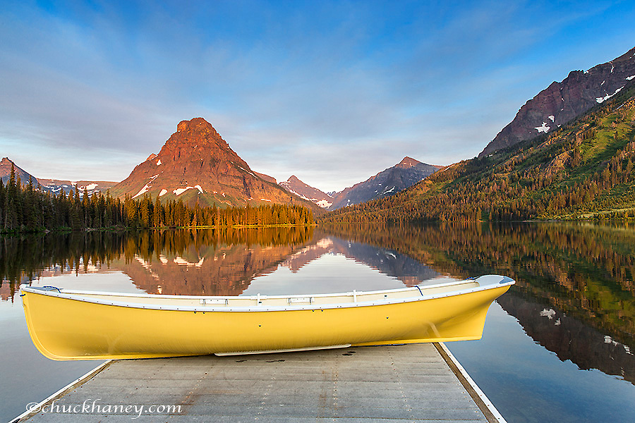 Yellow boat on calm morning at Two Medicine Lake in Glacier National Park, Montana, USA