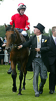 SIR ALEX FERGUSON LEADS IN ROCK OF GIBRALTER, WHICH WON THE ST JAMES PALACE STAKES, RIDDEN BY JOHNNY MURTAGH.