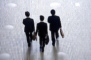 3 businessman on their way to a meeting
