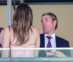 Liz Hurley with her partner Shane Warne enjoy watching the races at <br /> Ascot Racecourse, Ascot, United Kingdom<br /> Saturday, 27th July 2013<br /> Picture by  i-Images