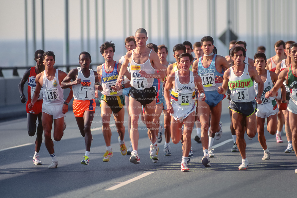 NEW YORK - NOVEMBER 3:  The lead pack of male runners competing in the 1991 New York City Marathon cross the Verrazzano Bridge from Staten Island to Brooklyn near the beginning of the race on November 3, 1991 in New York, New York.  Visible runners include Peter Maher #24 of Canada, Juma Ikaanga #1 of Tanzania, Jose Guerrero #53 of Colombia, Celso Allebrandt #136 of Brazil.     (Photo by David Madison/Getty Images)
