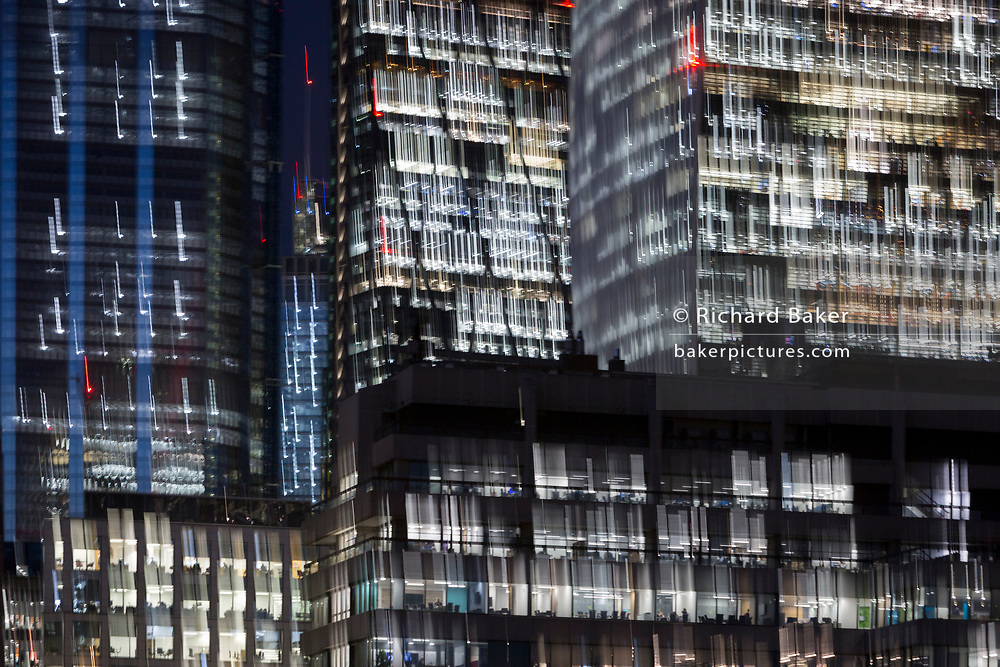Deliberate blur and zoom on generic office buildings in the City of London - the capital's financial district (aka The Square Mile), on 29th October 2018, in London, England.