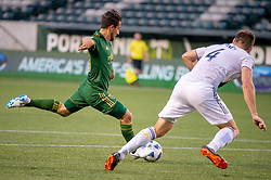 June 15, 2018 - Portland, Oregon, U.S. - PORTLAND, OR - JUNE 15: Portland Timbers midfielder Sebasti‡n Blanco shots past LA Galaxy defender Dave Romney to score the only goal of the Portland Timbers game versus the LA Galaxy in a United States Open Cup match on June 15, 2018, at Providence Park, OR. (Photo by Diego G Diaz/Icon Sportswire) (Credit Image: © Diego Diaz/Icon SMI via ZUMA Press)