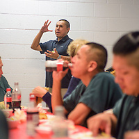 Jail Treatment Counselor Tyrone Kay shares his own story about dealing with alcohol abuse during a graduation luncheon at the McKinley County Adult Detention Center in Gallup Wednesday.