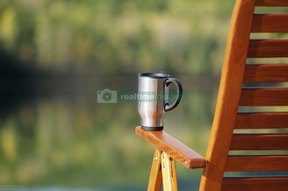 July 21, 2019 - Coffee Mug On Deck Chair (Credit Image: © Bilderbuch/Design Pics via ZUMA Wire)