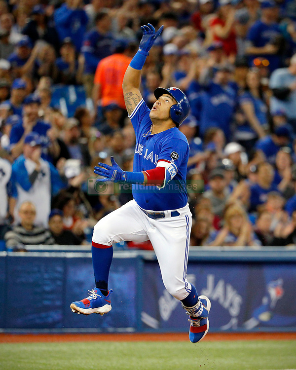 April 29, 2018 - Toronto, ON, U.S. - TORONTO, ON - APRIL 29: Toronto Blue Jays Infield Yangervis Solarte (26) jumps and gestures upward rounding 3rd after his solo home run in the 2nd inning during the MLB game between the Texas Rangers and the Toronto Blue Jays on April 29, 2018 at Rogers Centre in Toronto, ON. (Photo by Jeff Chevrier/Icon Sportswire) (Credit Image: © Jeff Chevrier/Icon SMI via ZUMA Press)