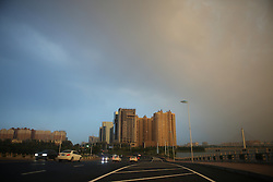 September 12, 2016 - Binzhou, Binzhou, China - Binzhou, CHINA-?September 11 2016:?(EDITORIAL?USE?ONLY.?CHINA?OUT) ..Dark clouds in the sky in Binzhou, east China¡¯s Shandong Province. The thunder rain hits Binzhou because of severe convection weather, which makes the place look like a city in disaster movies. (Credit Image: © SIPA Asia via ZUMA Wire)