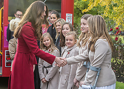 """© Licensed to London News Pictures. 07/11/2013. The Duke and Duchess of Cambridge hopped aboard the Royal British Legion's Poppy bus today as the charity aimed to collect a million pounds in one day. The Royal couple met with former and serving soldiers at Kensington Palace  as well as """"The Poppy Girls"""". Photo credit: Alison Baskerville/LNP"""