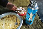 Mongolian yak butter and thermos depicting a winning wrestler.