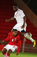 Ashley Williams of Wales battles for the ball with Joel Kitenge. . friendly international match, Wales v Luxembourg at the Parc y Scarlets stadium in  Llanelli on Wed 11th August 2010. pic by Andrew Orchard, Andrew Orchard sports photography,