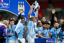 Vincent Kompany of Manchester City lifts the Capital One Cup after Manchester City win the match on Penalties - Mandatory byline: Rogan Thomson/JMP - 28/02/2016 - FOOTBALL - Wembley Stadium - London, England - Liverpool v Manchester City - Capital One Cup Final.