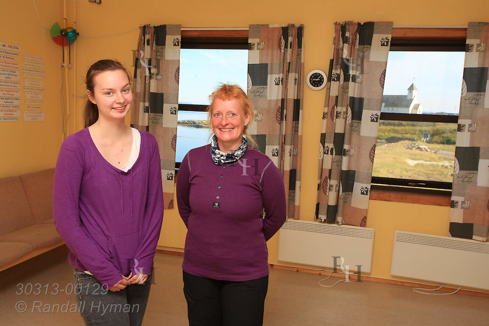 Andrine Klausen, the only student of her teacher, Kirsten Wollan, stand in the last classroom in the last school in its last year in the town of Ingoy on Ingoya island, Finnmark, Norway.