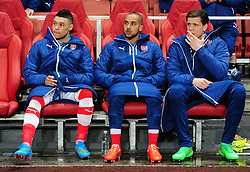 Theo Walcott of Arsenal and Wojciech Szczesny of Arsenal and also Alex Oxlade-Chamberlain of Arsenal take there place on the bench prior to kick off. - Photo mandatory by-line: Alex James/JMP - Mobile: 07966 386802 - 25/02/2015 - SPORT - Football - London - Emirates Stadium - Arsenal  v Monaco - Champions League - Round of 16