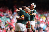 Juan De Jongh of South Africa (l) celebrates his try with teammates Ricky Januarie (9) and Gio Aplon (r). Wales v South Africa,    at Millennium Stadium in Cardiff on Sat 5th June 2010. pic by Andrew Orchard,  Andrew Orchard sports photography,