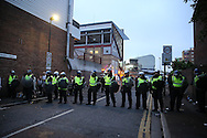 a Police line outside Boleyn Ground during the 1st half of the match. scenes around the Boleyn Ground, Upton Park in East London as West Ham United play their last ever game at the famous ground before their move to the Olympic Stadium next season. Barclays Premier league match, West Ham Utd v Man Utd at the Boleyn Ground in London on Tuesday 10th May 2016.<br /> pic by John Patrick Fletcher, Andrew Orchard sports photography.