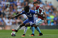 Victor Moses of Chelsea holds off Johann Gudmundsson of Burnley (r). Premier league match, Chelsea v Burnley at Stamford Bridge in London on Saturday 27th August 2016.<br /> pic by John Patrick Fletcher, Andrew Orchard sports photography.