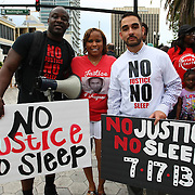 """Event organizers Olumide Ajile (L) and Shayan Modarres (r) pose with a supporter prior to the No Justice No Peace- """"March Against Gun Violence""""  walk from Lake Eola in downtown Orlando, to the Orange County Courthouse on Wednesday, July 17, 2013. The march was organized by the Modarres Law Firm and Orlando attorney Natalie Jackson, one of the attorneys for Trayvon Martins parents. (AP Photo/Alex Menendez)"""