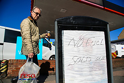 © Licensed to London News Pictures. 03/10/2021. London, UK. A man walks past 'NO FUEL - SOLD OUT' sign outside theTesco petrol station in north London as the fuel crisis continues. The petrol station has run out of petrol and has limited supply of diesel, which will last until 2pm today. From tomorrow (4 October) military personnel, including 100 drivers, will start fuel deliveries. Photo credit: Dinendra Haria/LNP
