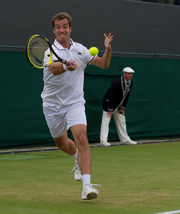 Richard Gasquet FRA (18) in action today during his defeat by Florian Mayer GER (31) in their Gentlemen's Singles Fourth Round match - Florian Mayer GER (31) def Richard Gasquet FRA (18) 6-3 6-1 3-6 6-2..Tennis - Wimbledon Lawn Tennis Championships - Day 8 - Tuesday 3rd July 2012 -  All England Lawn Tennis and Croquet Club - Wimbledon - London - England...