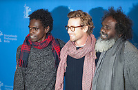 Actors Jacob Junior Nayinggul, Simon Baker and  Witiyana Marika at the photocall for the film High Ground at the 70th Berlinale International Film Festival, on Sunday 23rd February 2020, Hotel Grand Hyatt, Berlin, Germany. Photo credit: Doreen Kennedy