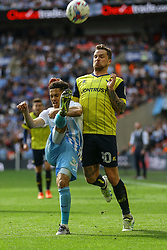 Dion Kelly-Evans of Coventry City clears the ball under pressure, from Chris Maguire of Oxford United - Photo mandatory by-line: Jason Brown/JMP -  02/04//2017 - SPORT - Football - London - Wembley Stadium - Coventry City v Oxford United - Checkatrade Trophy Final