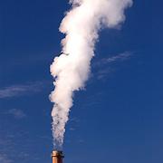 Smokestacks discharge into the sky
