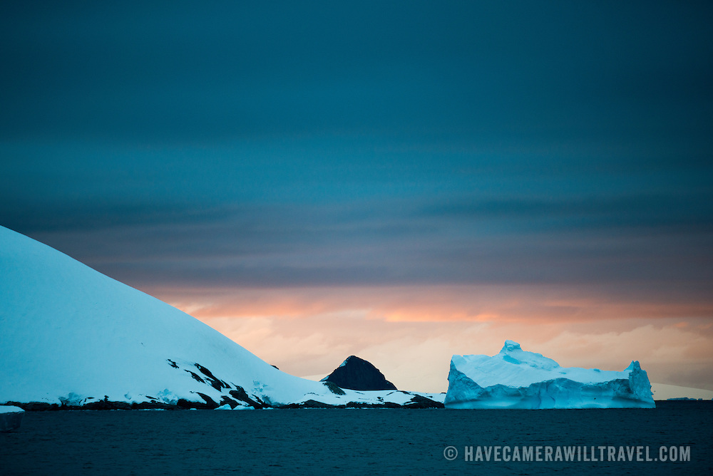 As the sun dips below the horizon for the short night of the Antarctic summer, it casts subtle colors in the sky above.