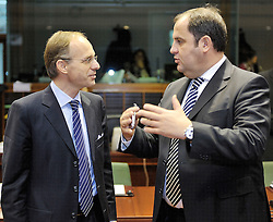 Luc Frieden, Luxembourg's minister of Finance, left, speaks with Josef Proell, Austria's finance minister, during ECOFIN, the meeting of EU finance ministers, at the European Council headquarters in Brussels, Belgium, on Tuesday, Nov. 10, 2009. (Photo © Jock Fistick)