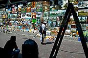 KRAKAU, POLAND - 07/07/2005 - TRAVEL, Pijarka's art market. Tourist looking at a wall of paintings<br /> <br /> © Christophe VANDER EECKEN