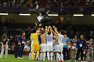Hong Myung Bo, coach of Korea is thrown up in the air as they celebrate their victory over Japan.  Olympic games 2012, mens football bronze medal match, Korea v Japan at the Millennium Stadium in Cardiff, South Wales on Friday 10th August 2012. pic by Andrew Orchard, Andrew Orchard sports photography,