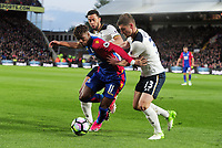 Football - 2016 / 2017 Premier League - Crystal Palace vs. Tottenham Hotspur<br /> <br /> Wilfried Zaha of  Crystal Palace takes on Ben Davies and Mousa Dembele of Spurs at Selhurst Park.<br /> <br /> COLORSPORT/ANDREW COWIE