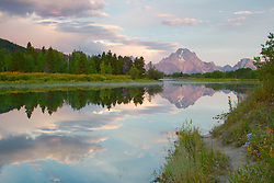 """Path to reflection. A foot path along the Oxbow Bend of the Snake River leads the eye into the photo.  Sunrise at Oxbow Bend in Grand Teton National Park<br /> <br /> For production prints or stock photos click the Purchase Print/License Photo Button in upper Right; for Fine Art """"Custom Prints"""" contact Daryl - 208-709-3250 or dh@greater-yellowstone.com"""