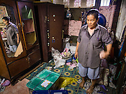 15 SEPTEMBER 2016 - BANGKOK, THAILAND:  A resident of Pom Mahakan packs her belongings on the day she moved out of the slum. She accepted money from Bangkok city government and left voluntarily. Forty-three families still live in the Pom Mahakan Fort community. The city of Bangkok has given them provisional permission to stay, but city officials say the permission could be rescinded and the city go ahead with the evictions. The residents of the historic fort have barricaded most of the gates into the fort and are joined every day by community activists from around Bangkok who support their efforts to stay.                     PHOTO BY JACK KURTZ