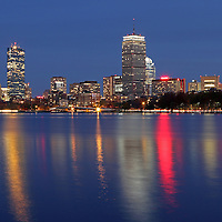 Boston skyline photography image featuring famous architecture landmarks such as the Boston Prudential Center, John Hancock Building and Back Bay brownstones reflected in the Charles River. The cityscape photograph was taken in November at twilight minutes after sunset.<br /> <br /> Boston provides the local and travel photographer with unique and beautiful architecture. The city is a wonderful mix of historic and modern buildings that make for fantastic photo subjects. Early morning and late afternoon often provide the best light for stunning skyline photography; however it is no secret that twilight makes for great photography as well. <br /> <br /> This Boston skyline photography images of the famous architecture landmarks at the banks of the Charles River is available as museum quality photography prints, canvas prints, acrylic prints or metal prints. Prints may be framed and matted to the individual liking and decorating needs:<br /> <br /> http://juergen-roth.artistwebsites.com/featured/friday-night-and-loving-it-juergen-roth.html<br /> <br /> All photographs are available for digital and print use at www.ExploringTheLight.com. Please contact me direct with any questions or request.<br /> <br /> Good light and happy photo making! <br /> <br /> My best, <br /> <br /> Juergen<br /> www.RothGalleries.com<br /> www.ExploringTheLight.com<br /> Twitter: @NatureFineArt<br /> Facebook: https://www.facebook.com/naturefineart