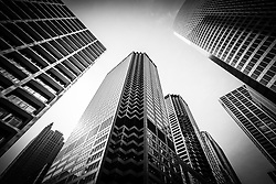 Chicago architecture in black and white with city skyscrapers looking up toward the sky