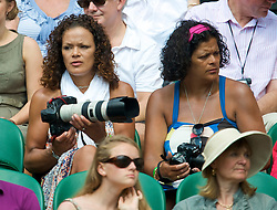 LONDON, ENGLAND - Saturday, June 27, 2009: Two spectators with high powered cameras and lenses take photographs during the Gentlemen's Singles 3rd Round match on day six of the Wimbledon Lawn Tennis Championships at the All England Lawn Tennis and Croquet Club. (Pic by David Rawcliffe/Propaganda)