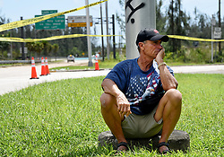 """Key Largo resident Warren Stincer, 64, sits frustrated that officials won't allow anyone into the Florida Keys Monday afternoon, September 11, 2017 because they don't know the full extent of the damage to infrastructure after Hurricane Irma cut through the Florida Keys Saturday and Sunday. """"First time evacuating and I'll never evacuate again,"""" said Stincer, who's a boat captain. """"I'm concerned for my animals. I want to go home and there's no reason for them to keep me from my home."""" Stincer has lived in Key Largo since he came to the United States from Cuba in 1956. """"There's no concern between here and my home."""" Photo by Taimy Alvarez/Sun Sentinel/TNS/ABACAPRESS.COM"""