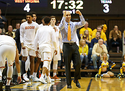 Jan 20, 2018; Morgantown, WV, USA; Texas Longhorns head coach Shaka Smart celebrates from the bench during the first half against the West Virginia Mountaineers at WVU Coliseum. Mandatory Credit: Ben Queen-USA TODAY Sports