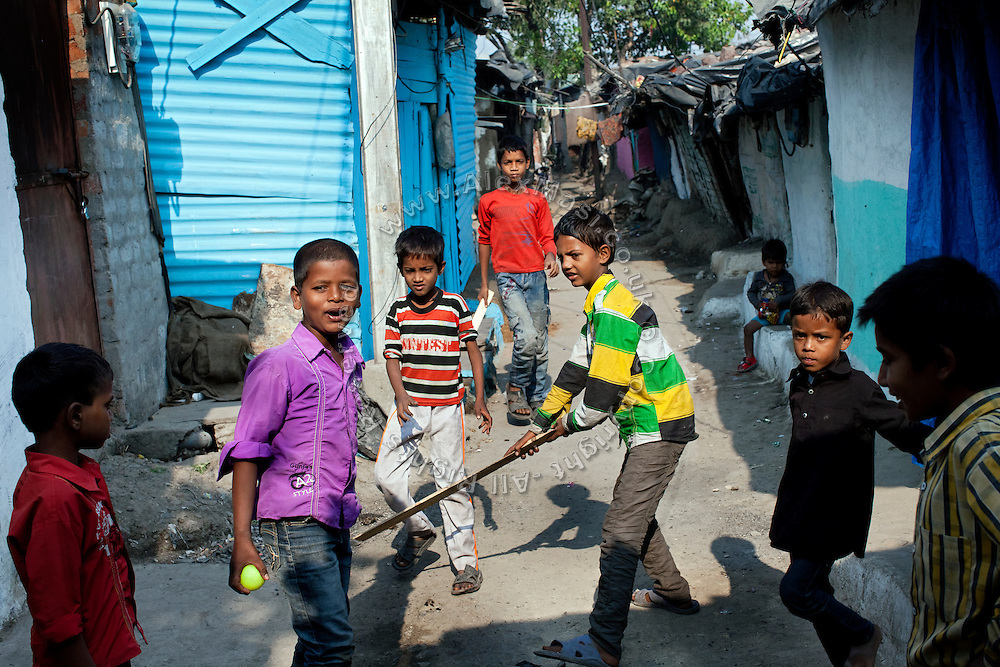 Boys are playing crickets on the streets of New Arif Nagar, one of the water-affected colonies standing next to the abandoned Union Carbide (now DOW Chemical) industrial complex, site of the infamous 1984 gas tragedy in Bhopal, Madhya Pradesh, central India. The poisonous cloud that enveloped Bhopal left everlasting consequences that today continue to consume people's lives.