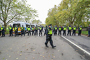 "Police form a line during a ""Match the Million"" march for free speech, free assembly, and freedom from lockdowns in Hyde Park, Central London, on Saturday, Oct 10, 2020. (VXP Photo/ Vudi Xhymshiti)"