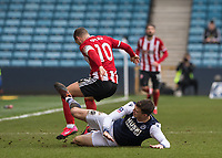 Football - 2019 / 2020 Emirates FA Cup - Fourth Round: Millwall vs. Sheffield United<br /> <br /> Tackles go flying in as Jake Cooper (Millwall FC) gets the better of Billy Sharp (Sheffield United) at The Den.<br /> <br /> COLORSPORT/DANIEL BEARHAM