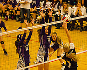 Hannah Knight, left and Rebekah Parr elevate block an attack by Oklahoma Union during Friday's match. - Nicholas Rutledge/For The Transcript (Published on Saturday, October 11, 2014)