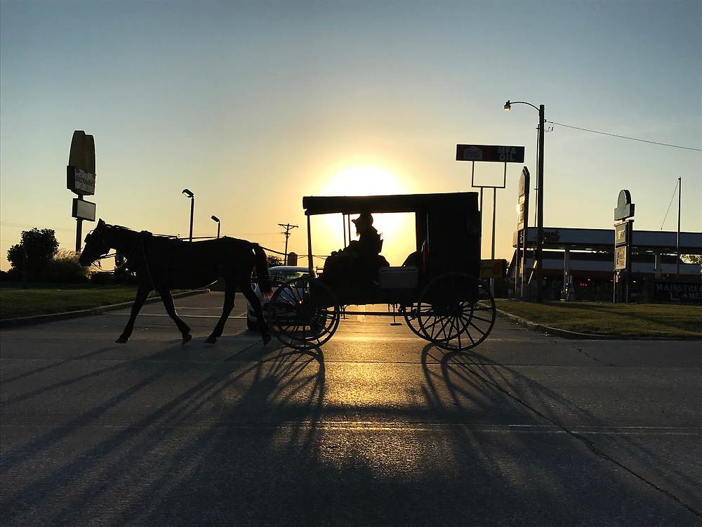 A Mennonite passes by in the late afternoon. Taken as part of the 71st Missouri Photo Workshop in Boonville, Mo.