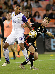 September 9, 2017 - Washington, DC, USA - 20170909 - Orlando City FC defender TOMMY REDDING (29) and D.C. United forward PATRICK MULLINS (16) battle for the ball in the second half at RFK Stadium in Washington. (Credit Image: © Chuck Myers via ZUMA Wire)