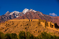 """The Stone Castle,  in Tashkurgan, Xinjiang Province, China with the Pamir Mountains behind. Tashkurgan means """"the stone castle"""" in Uygur. The town sits at 10,100 feet, along the Karakoram Highway. It was a caravan stop on the Silk Road and all routes of the Silk Road converged here to journey southward to Pakistan. It sits on the borders of both Afghanistan and Tajikistan, and is close to the border of Kyrgyzstan and Pakistan.  The majority population in the town are ethnic Mountain Tajiks. Xinjiang Province, China."""