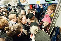 © Licensed to London News Pictures. 30/01/2015. London, UK. Commuters attempting to board a severely  overcrowded Thameslink cross London service during Friday morning rush hour, travelling into Central London.  Thames link are running a reduced carriage service as a result of flooding between Farringdon and St Pancras International due to a burst water main. Photo credit : Richard Isaac/LNP