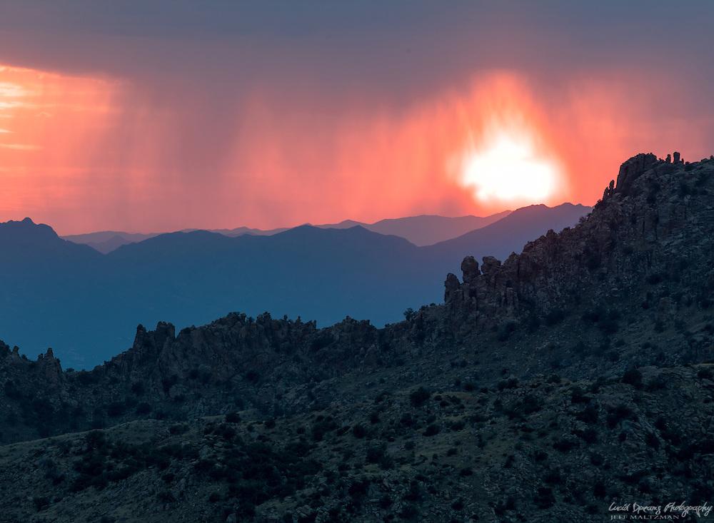 A fiery, stormy sunset over Santa Catalina hoodoos, Tucson