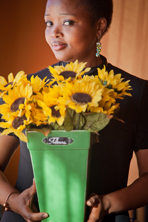 6.29.2012  Theresa P. Mashigo with sunflowers at Little Italy restaurant in south Anchorage