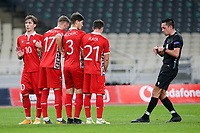 ATHENS, GREECE - OCTOBER 11: Moldova players and the referee Dennis Higler during the UEFA Nations League group stage match between Greece and Moldova at OACA Spyros Louis on October 11, 2020 in Athens, Greece. (Photo by MB Media)