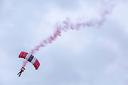 The Red Devils Army parachute display team during the Suffolk Show at the Suffolk Show Ground on the 29th May 2019 in Ipswich in the United Kingdom. The Suffolk Show is an annual show that takes place in Trinity Park, Ipswich in the English county of Suffolk. It is organised by the Suffolk Agricultural Association.